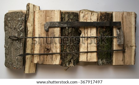 Original background about comfort and warmth,winter with firewood and fireplace tools. - stock photo