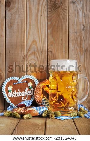 original bavarian gingerbread heart with Oktoberfest beer mug and soft pretzels - stock photo