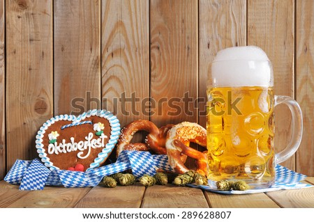 original bavarian Oktoberfest gingerbread heart with beer mug and soft pretzels from Germany - stock photo