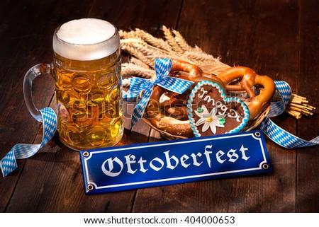Original bavarian pretzels with beer stein on wooden board. Oktoberfest background - stock photo