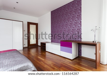 Original commode in room with violet purple wall - stock photo