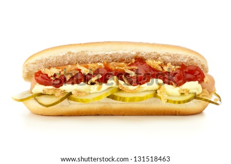 original Danish Hot dog with pickled cucumber slices, fried onions, ketchup and mayonnaise isolated on white background - stock photo