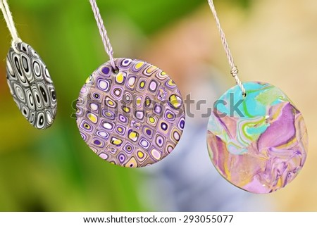 Original female ornaments from polymeric hand-worked clay - stock photo