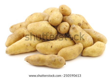 "original french ""ratte""potatoes (Solanum tuberosum) on a white background - stock photo"