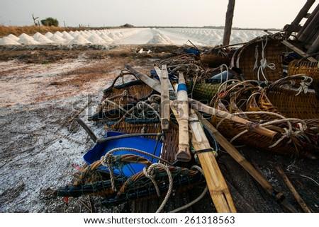 original heap of salt harvest tool in salt farm banleam petchaburi province central of thailand - stock photo