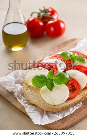 original Italian bruschetta with mozzarella and tomatoes - stock photo