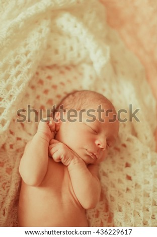 original portrait of a small fragile baby - stock photo