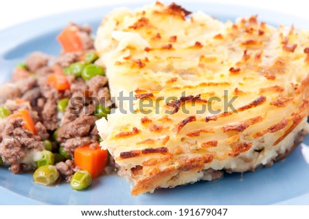original shepherd's pie made with ground lamb, fresh vegetables and mashed potatoes - stock photo