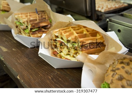 Original waffle sandwiches with meat and vegetables - stock photo