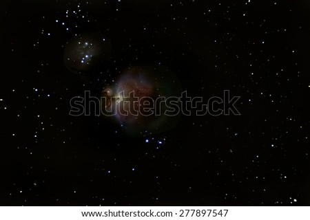 Orion Nebula deep space, beautiful night sky  The Orion Nebula is a diffuse nebula situated in the Milky Way south of Orion's Belt in the constellation of Orion - stock photo
