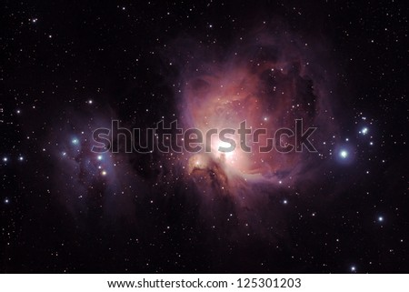 Orion Nebula (Messier M42) and the Running Man Nebula (NGC1977, left), two diffuse nebulas south of the Orion's belt in the constellation of Orion. 45minutes of exposure. - stock photo