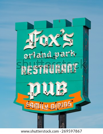 ORLAND PARK, ILLINOIS - APRIL 13: Colorful sign of the Fox's Restaurant Pub on April 13, 2015 in Orland Park, Illinois - stock photo