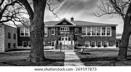 ORLAND PARK, ILLINOIS - APRIL 13: Historic Orland Park School (1922) on April 13, 2015 in Orland Park, Illinois - stock photo