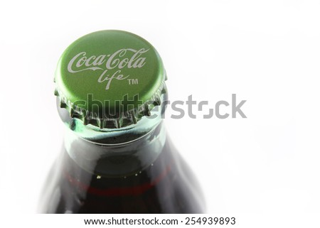 ORLANDO, FL - FEBRUARY 18, 2015: Coca-Cola Companys first reduced-calorie beverage sweetened with cane sugar and stevia leaf extract.  Packaged in 8 ounce glass bottles identified with a green label. - stock photo