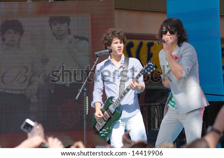 ORLANDO, FL - MARCH 28; Jonas Brothers performing on the Ellen Show at Universal Studios CityWalk. March 28, 2008 - stock photo