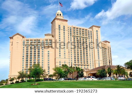 Orlando, Florida, USA - April 22, 2014: The JW Marriott Orlando hotel is part of the gorgeous Grande Lakes luxury complex including a dozen or so restaurants, convention center and golf course. - stock photo