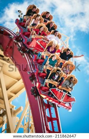 ORLANDO, FLORIDA, USA - JAN 8:  Riders enjoy the Rip Ride Rockit Rollercoaster at Universal Studios on January 8, 2011.  The ride is a steel rollercoaster that allows users to select their music. - stock photo