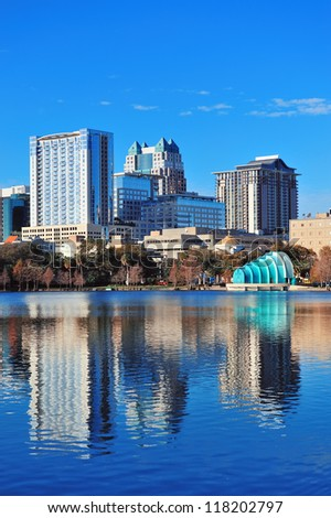 Orlando Lake Eola in the morning with urban skyscrapers and clear blue sky. - stock photo