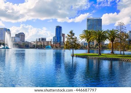 Orlando skyline fom lake Eola in Florida USA with palm trees - stock photo