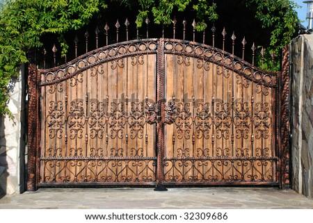 ornament forged big iron garden gate - stock photo