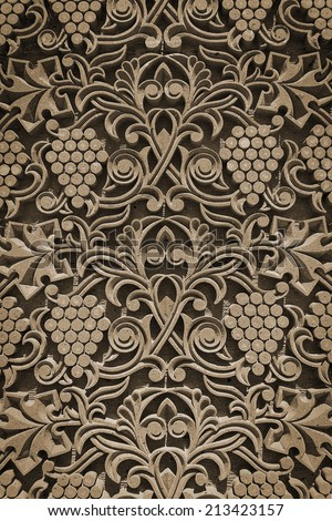 Ornament from grapes, grape leaves, lines and patterns handmade decorating the wall of the church in old style - stock photo