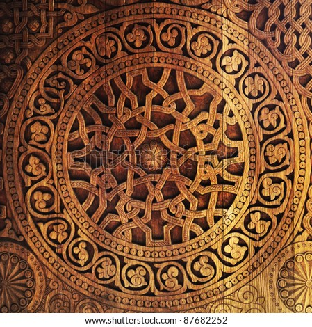 Ornament on wooden door - stock photo