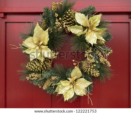 Ornamental Christmas wreath on red door - stock photo
