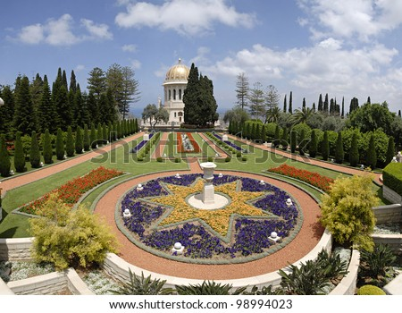 Ornamental garden of the Baha'i Temple in Haifa, Israel. This temple in Haifa houses the tomb of the Bab, and is world center of this religion. - stock photo