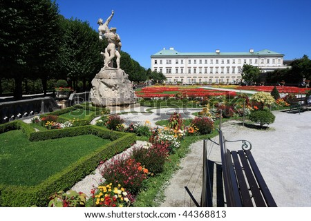 Ornamental gardens, beautiful flowers and Mirabell Palace in Salzburg, Austria - stock photo