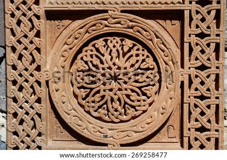 Ornamental knotworks of armenian cross stones - khachkars,medieval christian art,unesco world heritage site  - stock photo
