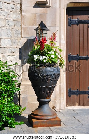 Ornamental vase with flowers - stock photo