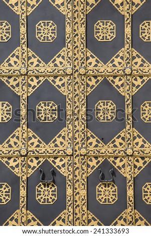 Ornamented gold door. Golden decoration of the door to Cathedral of the Dormition in Kiev Pechersk Lavra - famous monastery inscribed on UNESCO world heritage list. Ukrainian landmark. - stock photo