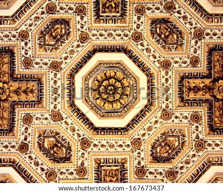 Ornaments on the ceiling in St Peter's Cathedral in Rome  - stock photo