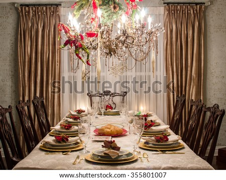 Ornate Christmas Dining Room Table with Dinner Settings - stock photo