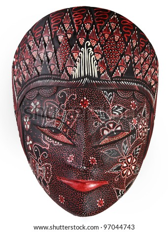 Ornate colorful mask carved from wood and painted - stock photo