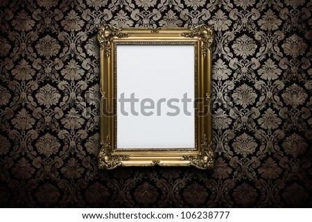 Ornate gold frame at grunge wallpaper with clipping path - stock photo