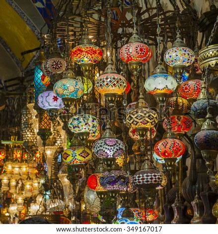 Ornate hanging glass lights at a stall in a market souk inside the grand bazaar Istanbul Turkey - stock photo