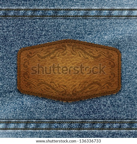 Ornate leather label with copyspace on denim background  - raster version - stock photo