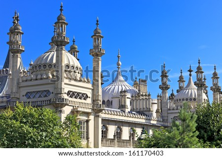 Ornate onion domes and minarets of Brighton regency palace the Royal Pavillion in East Sussex, England (UK) - stock photo