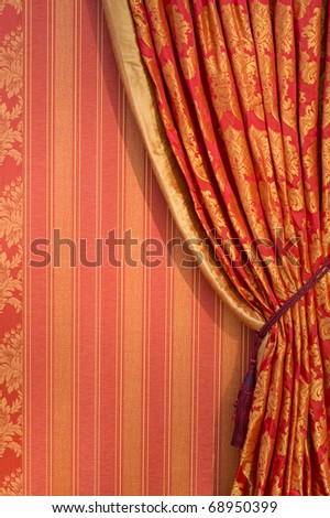 Ornate red curtain with ornaments covering the whole window, free copyspace - stock photo