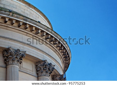 Ornate sandstone columns on government building - stock photo