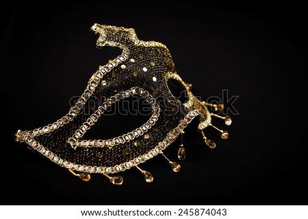 Ornate sequin mask isolated on black - stock photo