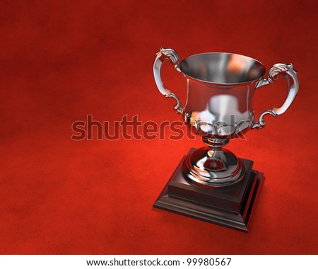 Ornate trophy cup on wooden plinth with red background. Includes copy space. - stock photo