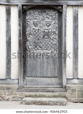 Ornate Wooden Door on the outside of a house - stock photo