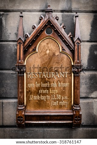 Ornate Wooden Sign For A Luxury Restaurant - stock photo