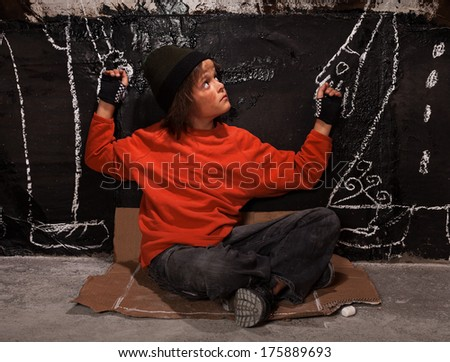 Orphan child on the street in need of help and guidance - stock photo
