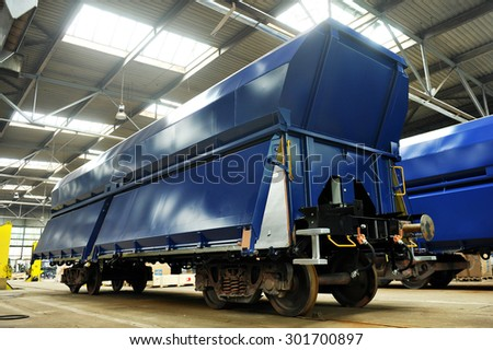 ORSOVA/ROMANIA - APRIL 25: Industry detail with a new freight wagon on the factory production line in Orsova, on April 25, 2014 in Romania. - stock photo