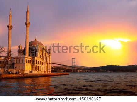 Ortakoy mosque and Bosphorus bridge, Istanbul, Turkey - stock photo