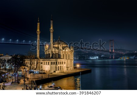 Ortakoy Mosque and the Bosphorus Bridge at night Istanbul Turkey - stock photo
