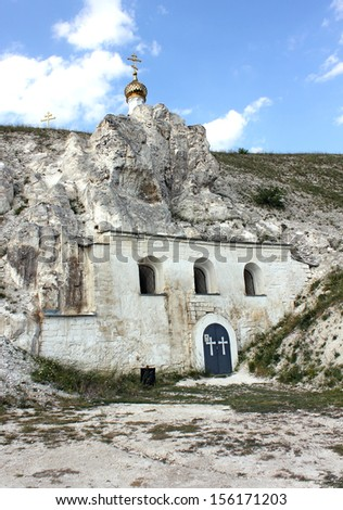 Orthodox cathedral carved out of natural rock, Russia, Voronezh region, museum Divnogorie, 2013 - stock photo